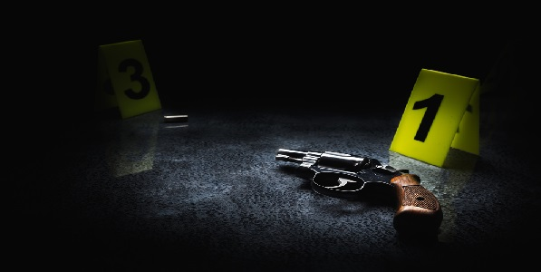 Crime scene concept with a gun and evidence markers, high contrast image